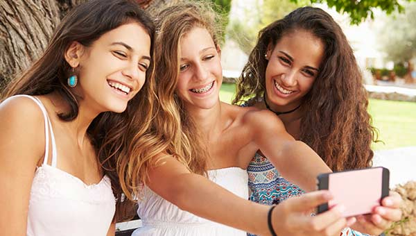 Teenagers Slider Pulsipher Orthodontics located in San Diego, CA